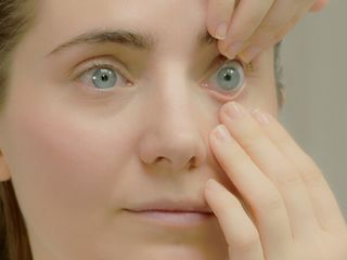 2. Gently pull down your lower eyelid