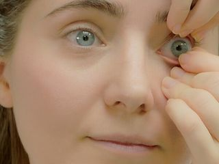 3. Gently pinch the contact lens off